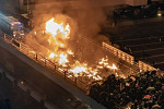 Hong Kong protesters set fire to...