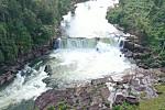 The huge rocky waterfalls are hidden...
