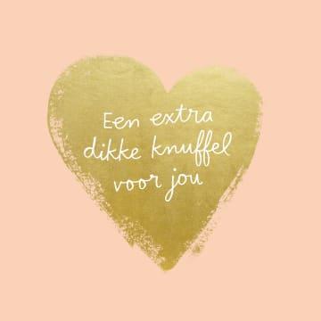 - Een-extra-dikke-knuffel-op-een-gouden-hart