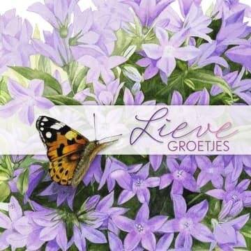 - een-vlinder-bij-bloemen