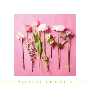 - lente-bloemen-op-roze-achtergrond