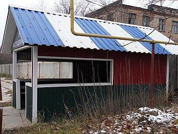 крыша из разноцветных листов профнастила