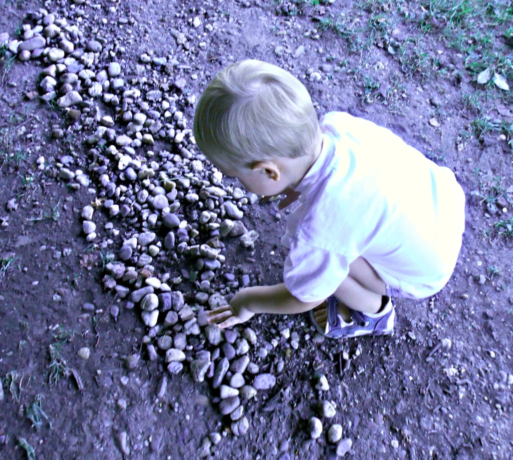 Improving motor skills in toddlers through play with rocks
