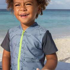 Baby sunsuit for boys in Surfing Dogs Lime