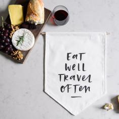 Eat well travel often wall flag