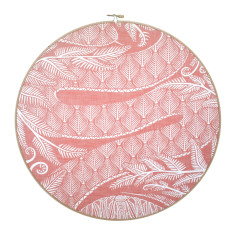 Screen-printed snakeskin framed in embroidery hoop in peach