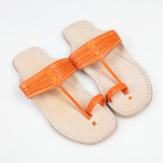 Handmade leather sandals in saffron orange