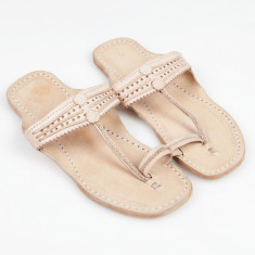 Handmade leather sandals in natural nude