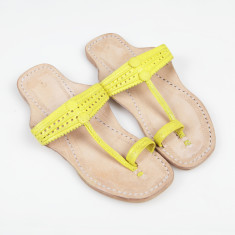 Handmade leather sandals in tumeric yellow