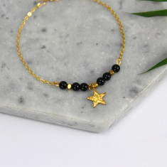 Gold star bracelet with semi-precious stones