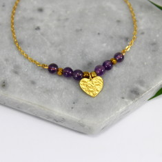 Gold heart charm bracelet with semi-precious stones