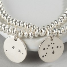 Silver zodiac constellation charm