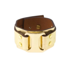 Buckle up cuff in gold by Michelle Caley