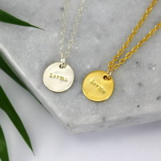 Engraved Karma charm necklace