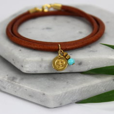 Gold plated ohm charm leather bracelet