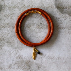 Gold plated feather charm leather bracelet