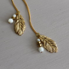 Feather charm necklace with mother of pearl stones