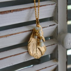 Gold plated feather charm necklace