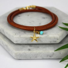 Gold plated starfish charm leather bracelet