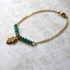 Vermeil gold ohm charm bracelet with turquoise stones