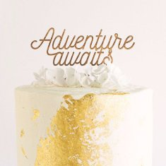 Adventure awaits cake topper in raw wood