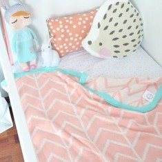 Peach herringbone blanket with mint trim