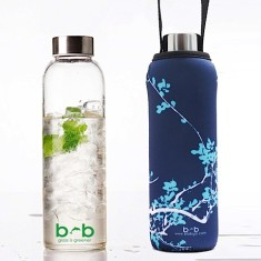 Glass is greener bottle with carry cover in blossom print