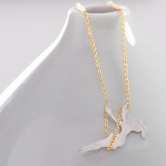 Silver girl on a swing necklace