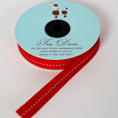 Christmas ribbon in light blue saddle stitch on red
