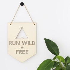 Run wild + free plywood banner
