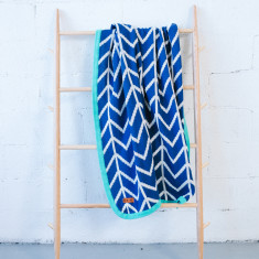 Navy herringbone blanket with turquoise trim