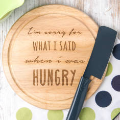 Engraved 'when I was hungry' wooden chopping board