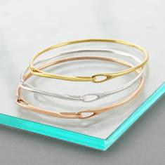 263f35824 Single Loop Gold And Silver Bar Bangle. by Otis Jaxon Silver Jewellery