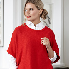 Reversible cotton cashmere poncho in flame red & spice