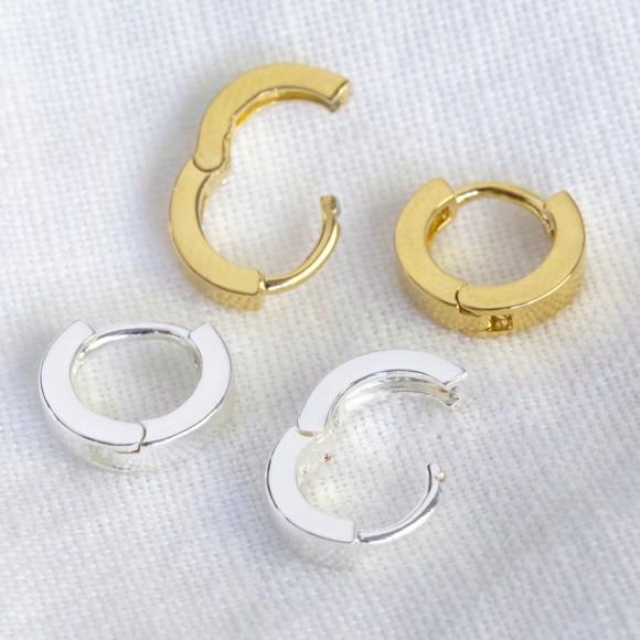 cdd86fe8b Tiny Sterling Silver Huggie Hoop Earrings. by Lisa Angel .