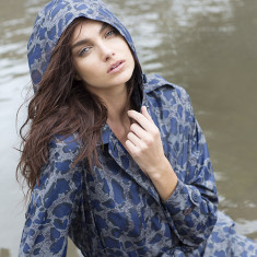 Women's packable travel raincoat in leopard