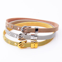 Buckle bracelet in gold, silver and rose gold by Torini