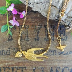 Verity gold swallow and heart necklace