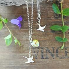 Brigitte silver swallow and Swarovski heart necklace