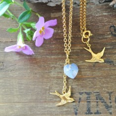 Brigitte gold swallow and Swarovski heart necklace