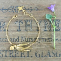 Violetta gold swallow and heart bracelet