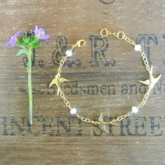 Babette gold swallows and pearl bracelet