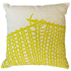 Knitting cushion cover in chartreuse on natural