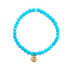 Gold & diamond sunflower charm on turquoise bracelet