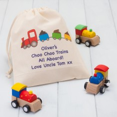 Set Of Three Wooden Train Wind Up Toys and Personalised Bag