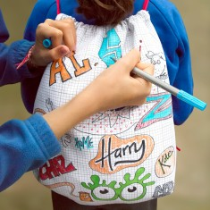 Doodle drawstring cotton backpack with wash-out pens