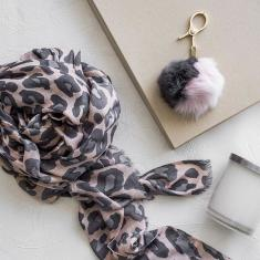 Animal print scarf in coral