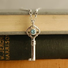 Skaill silver and blue topaz key pendant