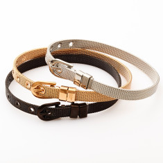 Buckle bracelet set in gold, silver and black by Torini
