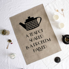 A teapot shared is a problem halved tea towel